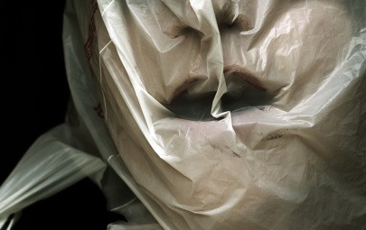 Woman with plastic bag over her head
